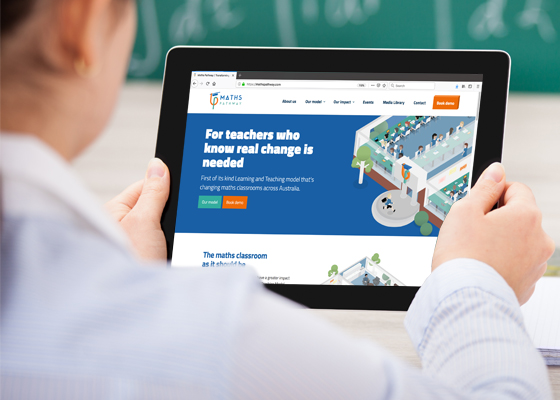 Hands holding ipad showing Maths Pathway custom website design